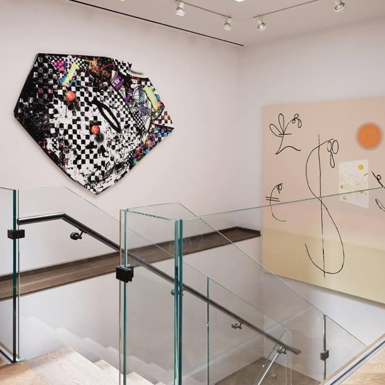 Interior view of LX featuring artworks by Aaron Curry and Florian Meisenberg. COURTESY MAX YAWNEY/LX ARTS