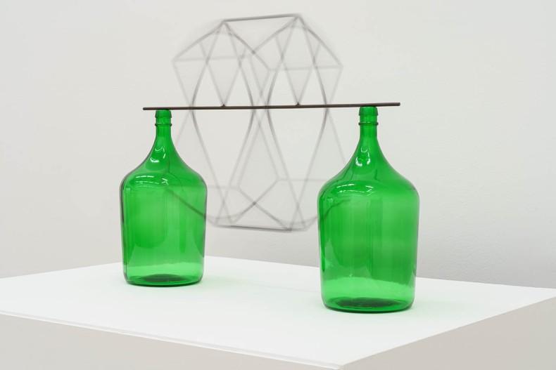 Raul Mourão Garrafão Caixa, 2020 aço 1020 com resina sintética e garrafa de vidro 48 x 67 x 26.5 cm