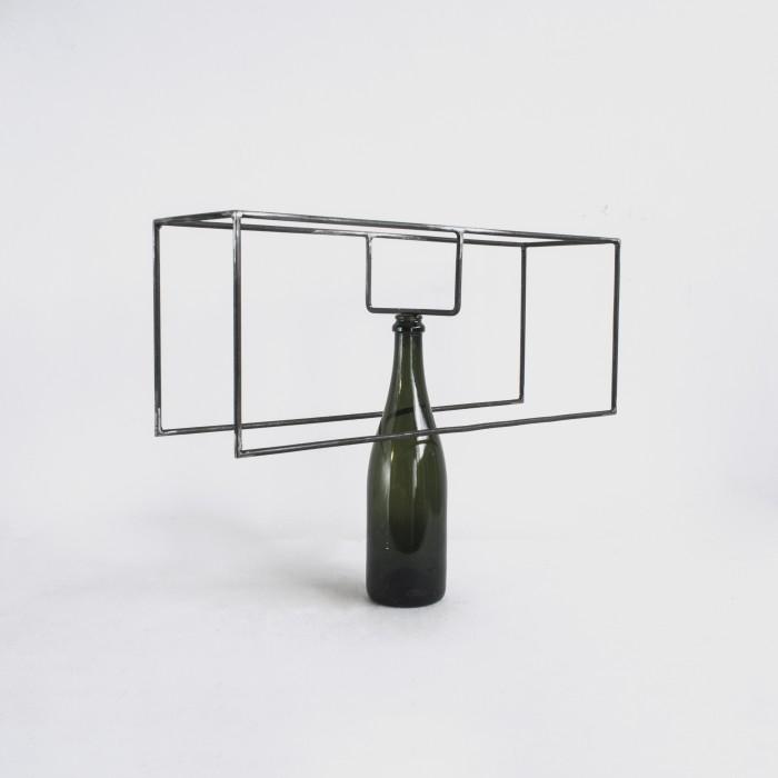 Raul Mourão Casco, 2019 corten steel and bottle 38,5 x 50 x 15 cm
