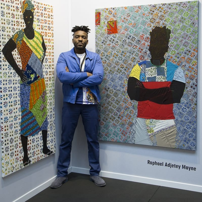 Raphael Adjetey Mayne with two of his works