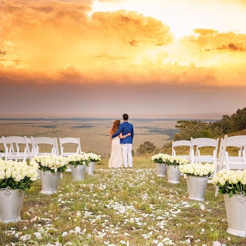 Image may contain: sky, cloud, wedding, outdoor and nature