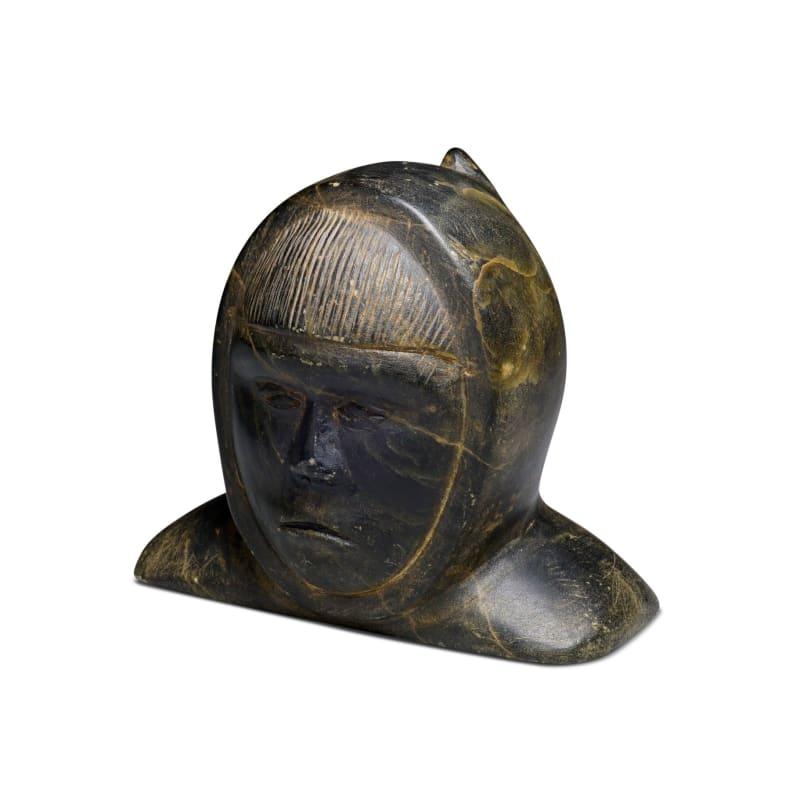 LOT 23  TERRY IRQITTUQ (1930-) SANIRAJAK (HALL BEACH) Bust of a Man, 1963 stone, 3 x 3 1/2 x 2 3/4 in (7.6 x 8.9 x 7 cm)  ESTIMATE: $150 — $250  Price realized: $120