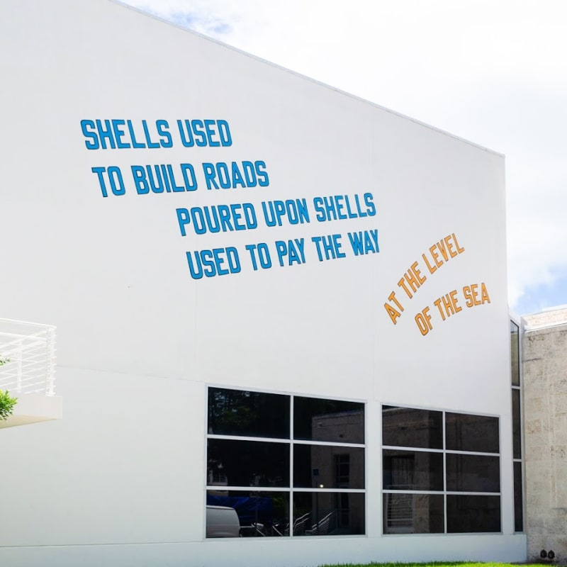 Image: Lawrence Weiner, SHELLS USED TO BUILD ROADS POURED UPON SHELLS USED TO PAY THE WAY, AT THE LEVEL OF THE SEA (2008) © Lawrence Weiner. Photography by Zaire Kacz
