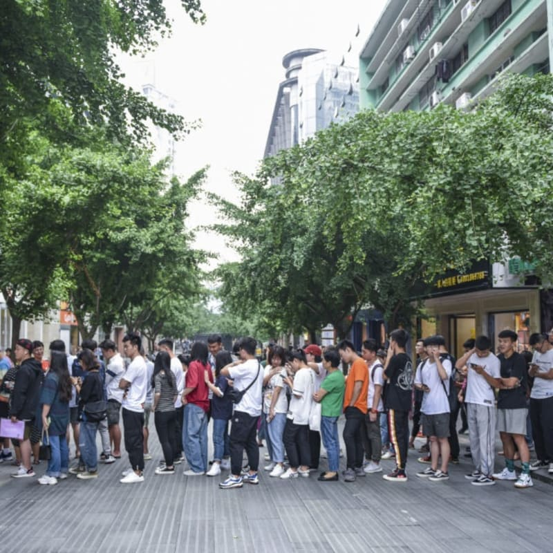 Customers queue up in front of a Uniqlo store to buy KAWS x Uniqlo collaborative collection on June 3, 2019 in Jinhua, Zhejiang Province of China. Photo by VCG/VCG via Getty Images.