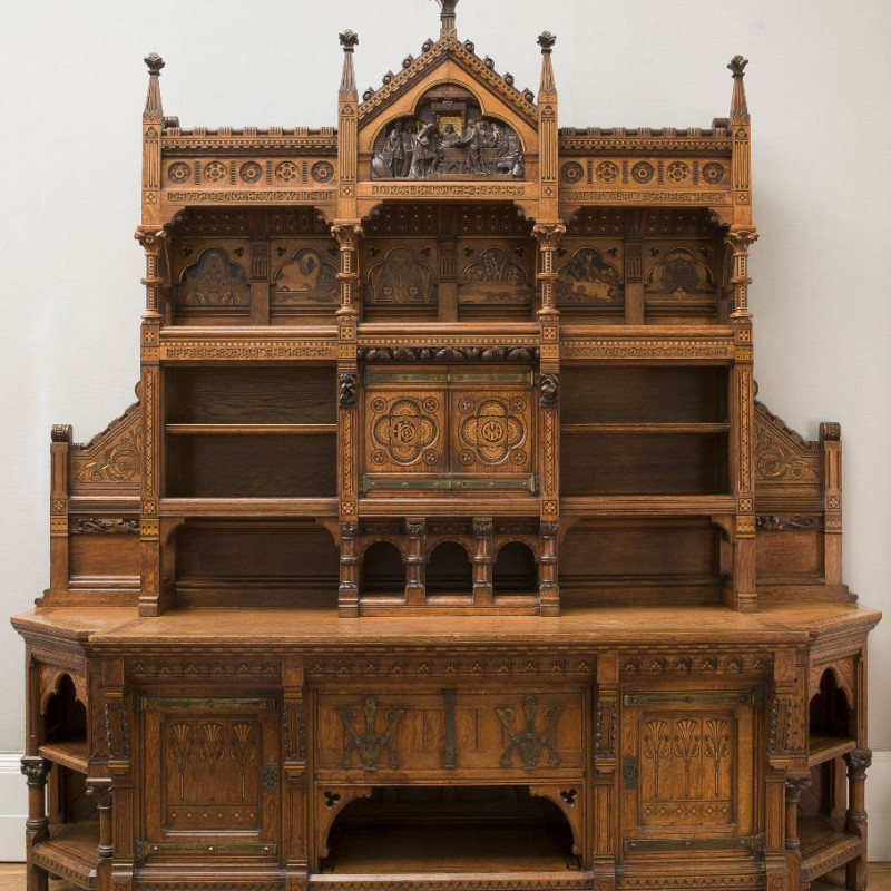 Bruce J. Talbert (1838-1881), Holland & Sons, London (maker), Pericles 'Dressoir', 1866. Oak, inlaid with ebony and fruitwoods, carved and gilded; brass hinges and fittings | 128 x 113 x 30 inches (325 x 287 x 76 cm)