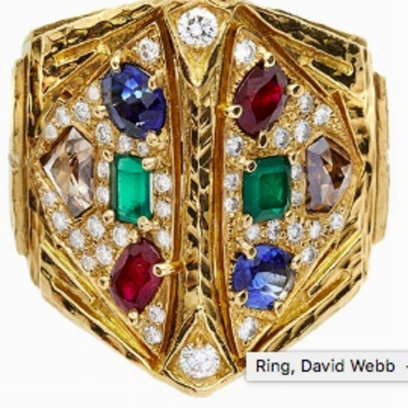RING, DAVID WEBB, USA, MID-SIXTIES MATERIAL: Yellow gold, sapphires, rubies, emeralds and diamonds fancy DESCRIPTION: sculpture ring made of beat gold and engraved with geometric motifs, pyramid-shaped, embellished on each side of a sapphire, a ruby, a emerald and a diamond fancy framed by diamonds pave, Webb signed bears the mark 18 kt MEASURES: 6 WEIGHT: 2.00 ct sapphire, emerald 2,00 ct, rubies 2,00 ct, fancy diamonds 2.00 ct, 0.60 ct diamonds, 31.7 g31.7 g