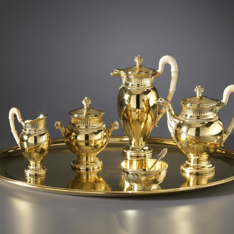 A late nineteenth century French solid silver-gilt seven-piece tea and coffee service by Puiforcat