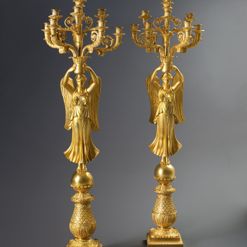 Thomire et Cie (attributed to), A pair of late Empire nine-light candelabra à la Victoire attributed to Thomire et Cie,...