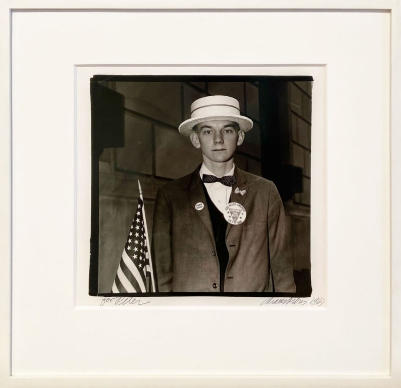 Diane Arbus (American, 1923-1971) Boy with a Straw Hat Waiting to March in a Pro-War Parade, NYC, 1967