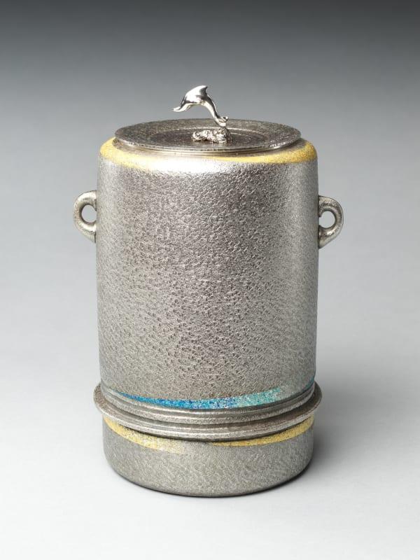 Miyata Ryohei (Japanese, born 1945). Silver Freshwater Jar with Dolphin (Nanryō irukamon mizusashi), 2020. Reiwa period (2019–present). Hammered silver with gold foil. H. 9 in. (22.9 cm); Diam. 7 in. (17.8 cm). The Metropolitan Museum of Art, Gift of Hayashi Kaoru, in celebration of the Museum's 150th Anniversary, 2020 (2020.390.4a, b). Image © Miyata Ryohei
