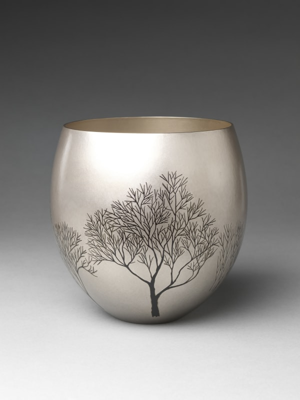Okuyama Hōseki (Japanese, born 1937). Winter Grove (Fuyu no kodachi) Flower Container, 1997. Heisei period (1989–2019). Hammered silver with inlaid copper and gold alloy (shakudō), copper and silver alloy (shibuichi). H. 7 1/2 in. (19.1 cm); Diam. 7 1/2 in. (19.1 cm). The Metropolitan Museum of Art, Gift of Hayashi Kaoru, in celebration of the Museum's 150th Anniversary, 2020 (2020.76.5). Image © Okuyama Hōseki