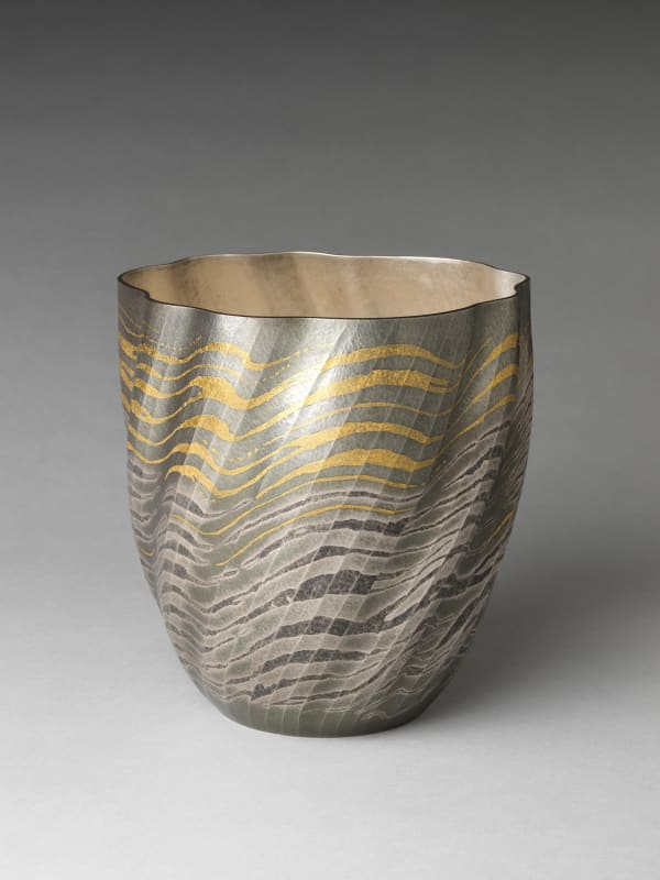 Osumi Yukie (Japanese, born 1945). High Tide Comes In (Shiomitsu), 2007. Heisei period (1989–2019). Hammered silver with nunomezōgan (textile imprint inlay) in lead and gold. H. 9 1/2 in. (24.1 cm); Diam. 9 in. (22.9 cm). The Metropolitan Museum of Art, Gift of Hayashi Kaoru, in celebration of the Museum's 150th Anniversary, 2020 (2020.76.1)