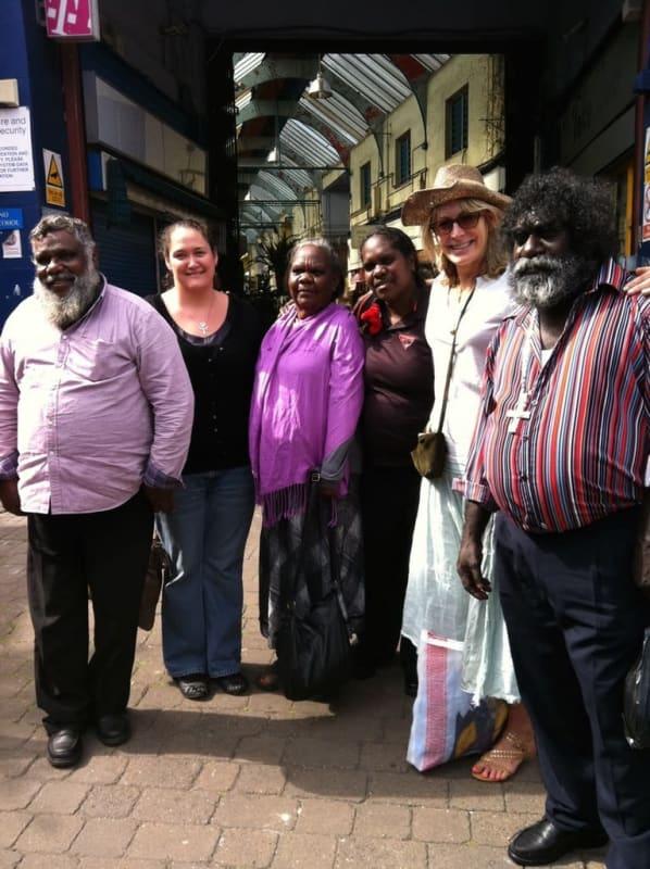 Rebecca Hossack with Borroloola artists at Brixton Market, London