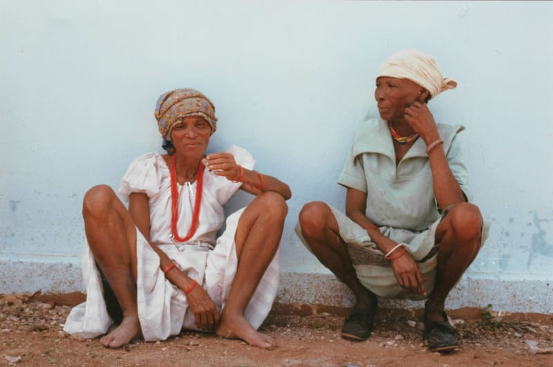 Rebecca's trip to the Kalahari: Dada and Bau taking a smoke break