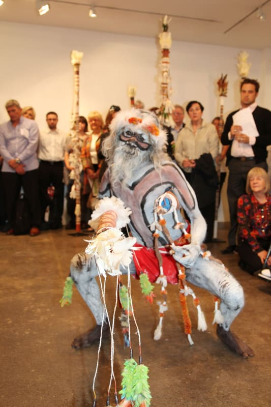 Gali Yalkarriwuy Gurruwiwi dancing with his Morning Star pole at the gallery