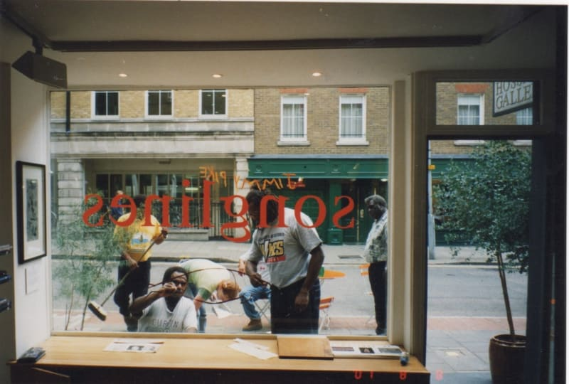 David Bosun, Billy Missi and Dennis Nona painting on the window at the Rebecca Hossack Art Gallery, London during their exhibition in 2001