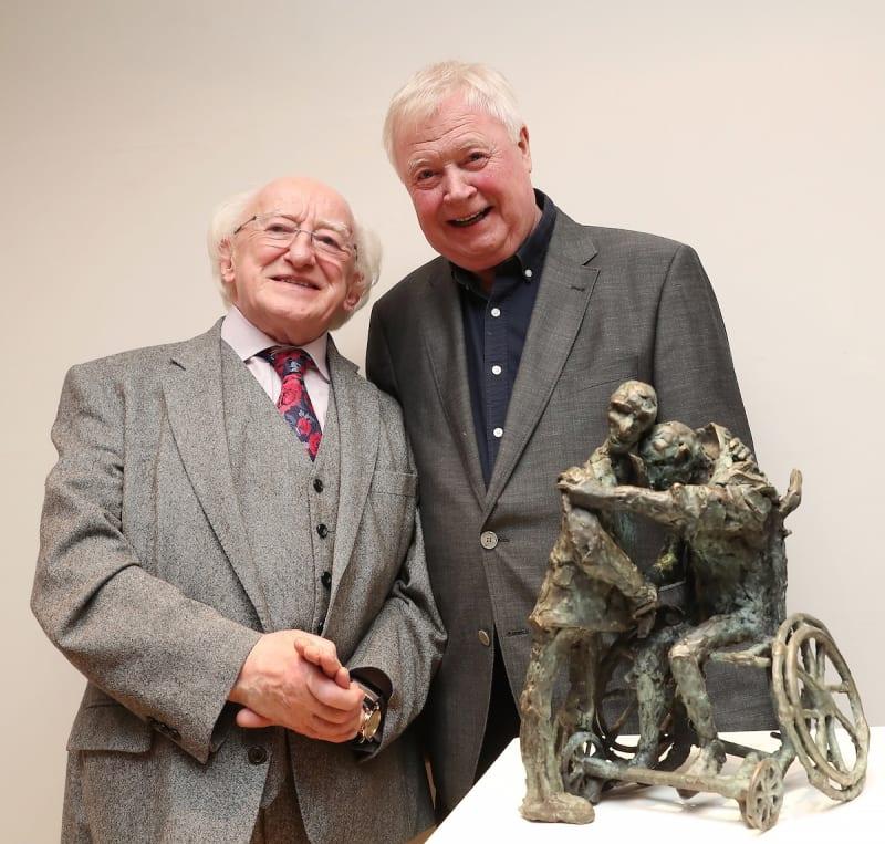 President Michael D. Higgins & artist John Behan RHA stand beside 'The Embrace' sculpture