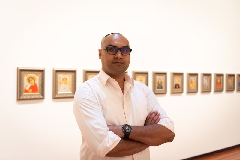 Isiaha Barlow in front of his work at the exhibition Every Artist, 2021, City Gallery Wellington. Photo by Harry Curly