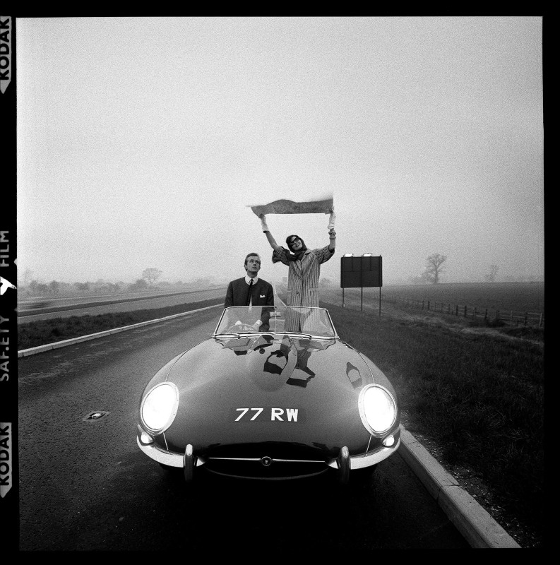 E-TYPE JAGUAR AT THE OPENING OF THE M1 MOTORWAY, VOGUE, 1960