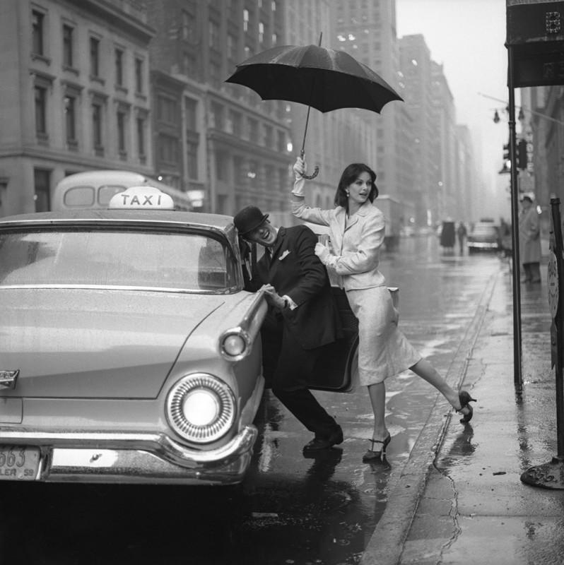 VOGUE: PUSHING MAN IN CAB, 1958