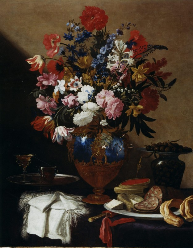 Vase of Flowers with Pale of Olives, Salami and Cheese, Preserves, a Chalice and a white fringed Cloth