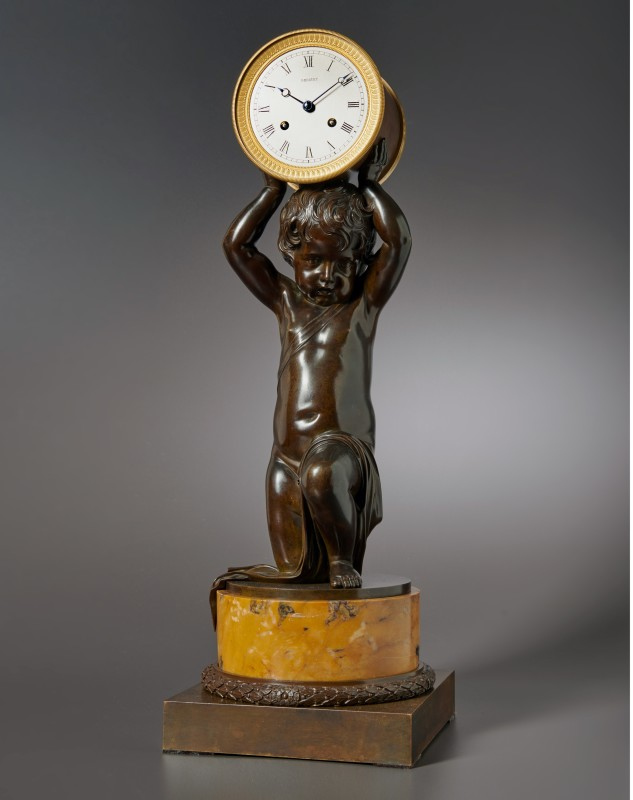 A figural clock of eight day duration of a kneeling putti by Breguet, Paris, date 1820-25