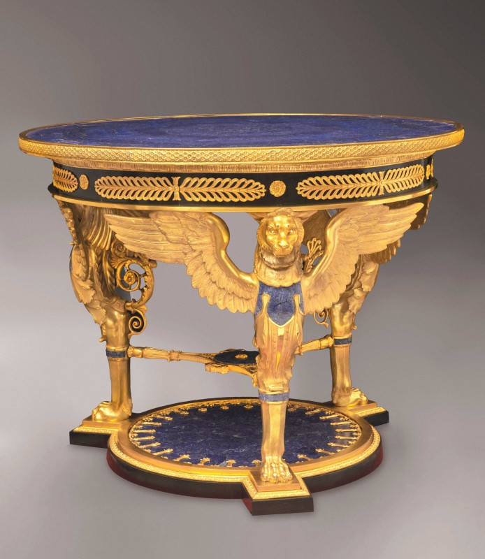 An Italian Empire style gilt bronze and lapislazuli-veneered center table, date circa 1980