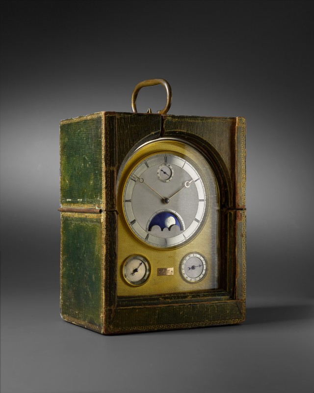 A late 19th century humpback travelling clock with moonphase by Jump, circa 1892