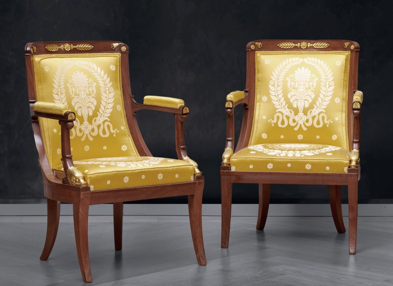 A set of six Empire fauteuils, with armrests decorated with heads of dolphins, Paris, date circa 1810