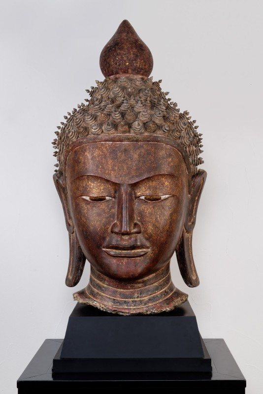 A nineteenth century Burmese carved and lacquered wooden head of Shakyamuni Buddha, Burma (Myanmar), nineteenth century