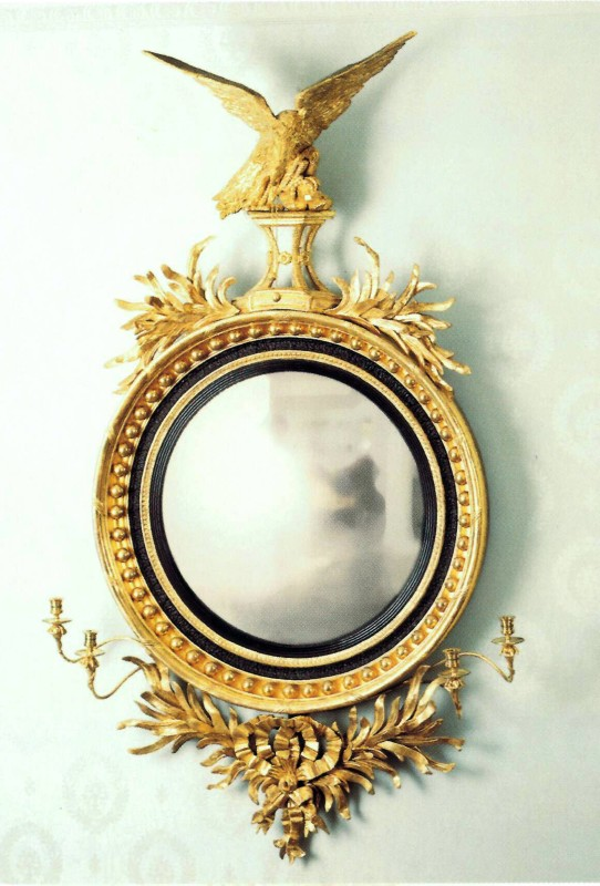 A Regency mirror fitted with a pair of two-light candelabra, England, date circa 1810