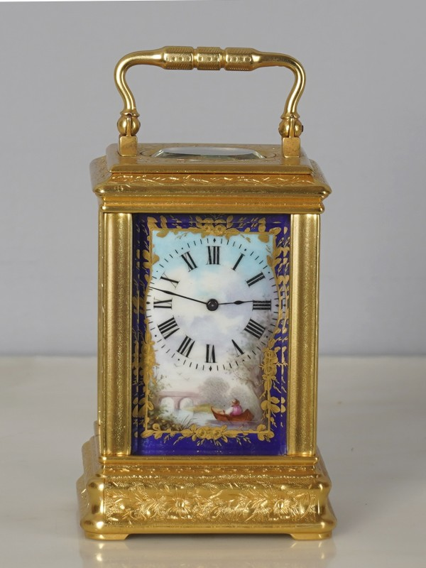 A French miniature carriage clock with 4 porcelain panels, Paris, date circa 1870