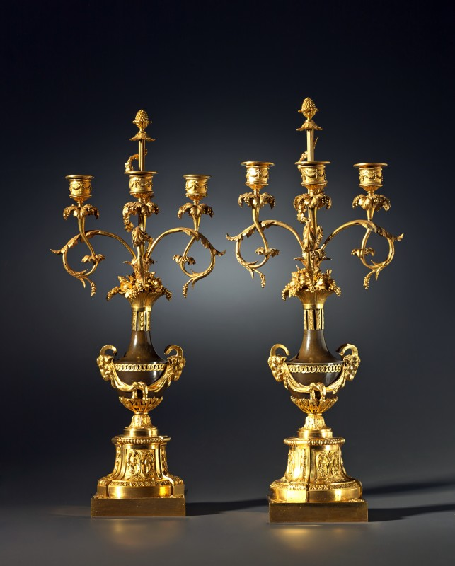 A pair of Louis XVI three-light figural candelabra, Paris, date circa 1785