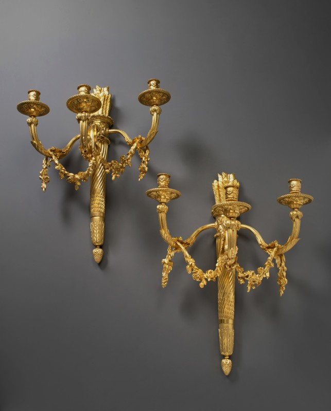 A pair of Louis XVI three-light wall-lights, Paris, date circa 1785-90