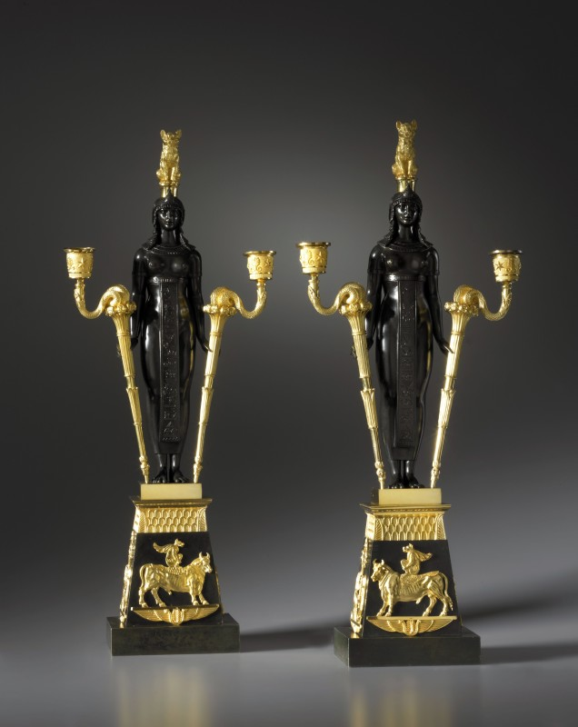 A pair of Empire two-light candelabra retour d'Egypte attributed to Pierre-Philippe Thomire after a design by Charles Percier, Paris, date circa 1810