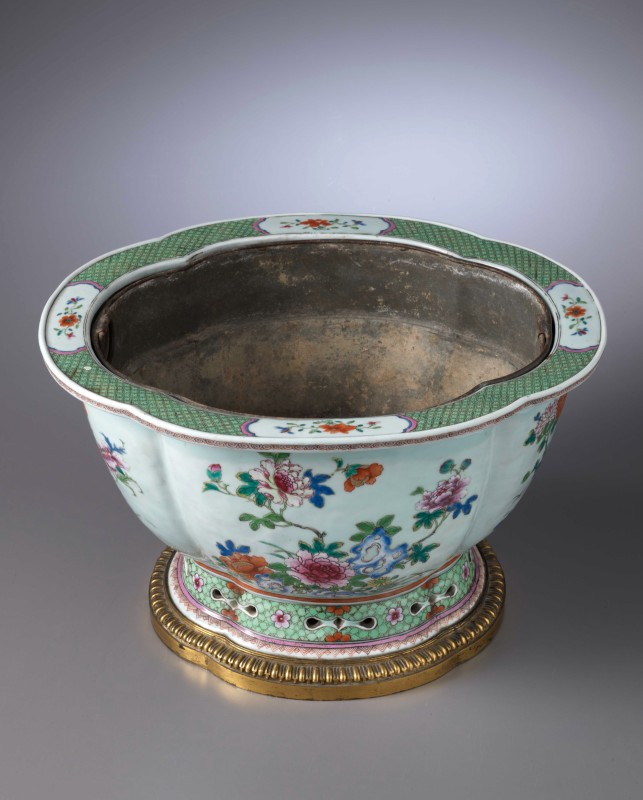 A Louis XVI Qianlong jardinière with a drainage hole at the base and tin liner, The porcelain: China, probably Jingdezhen, date circa 1735-45. The gilt bronze: Paris, mid eighteenth century