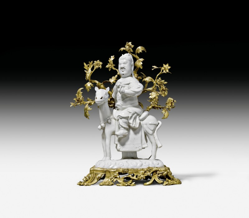 A Kangxi figure of Guan-Di seated on his horse, The figurine: Dehua, China, Kangxi period (1662-1722); the gilt bronze mounts: Paris, circa 1740