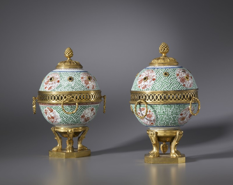 A pair of Régence pot-pourri vases with lid, The porcelain vases: China, most probably made at the Jingdezhen kilns, late Kangxi period, date circa 1700-25. The gilt bronze finials and bases: Paris, date circa 1715-20. The gilt bronze entrelac galleries: Paris, date circa 1710-20