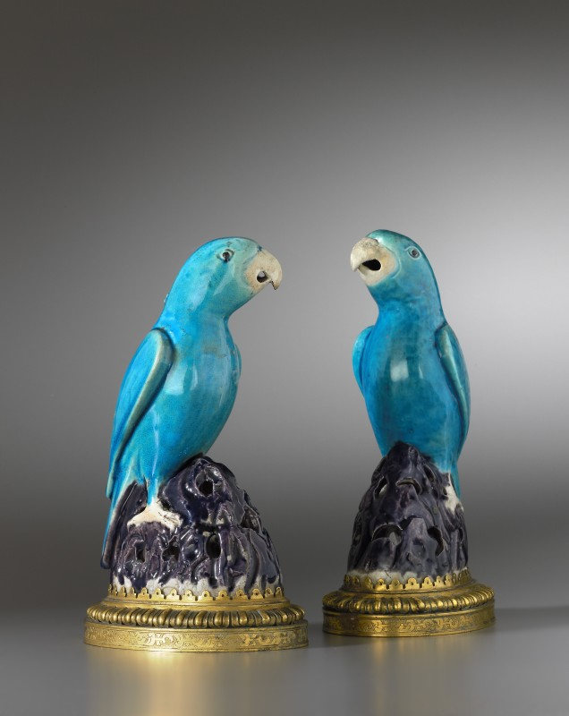 A pair of Régence Kangxi parrots, The porcelain parrots: China, probably Jingdezhen, Qing dynasty, Kangxi period, date circa 1700. The gilt bronzes: Paris, date circa 1720