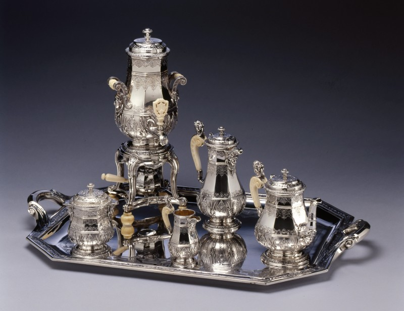 An Eclectic style five piece tea and coffee-service with matching water urn and tray by Edmond Tétard, Paris, dated 1885