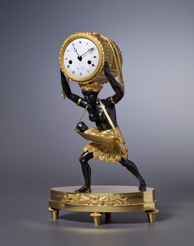 "An Empire mantel clock ""La Nourrice Africaine or the African Nursemaid"" by Sacré, housed in a case after a design by Louis Croutelle aîné, Paris, date circa 1810"