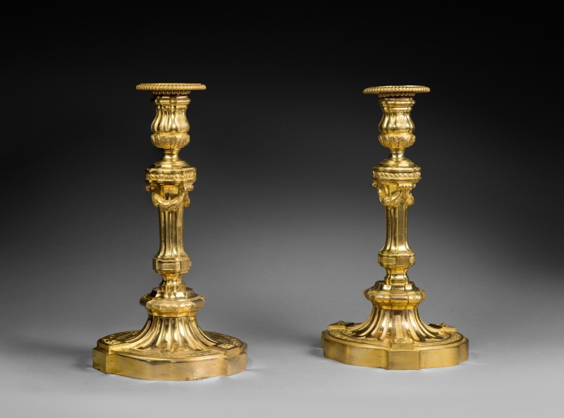 A pair of Transition Louis XV-Louis XVI candlesticks in the manner of Delafosse, Paris, date circa 1770