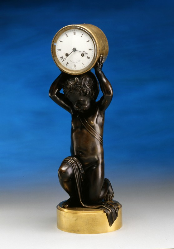 A figural clock of a kneeling putti, by Breguet et fils, Paris, date 1824