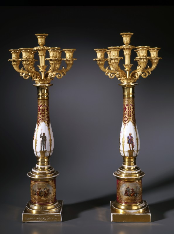 A pair of Restauration seven-light candelabra, The bronze: Paris. The porcelain: European, date circa 1820-30