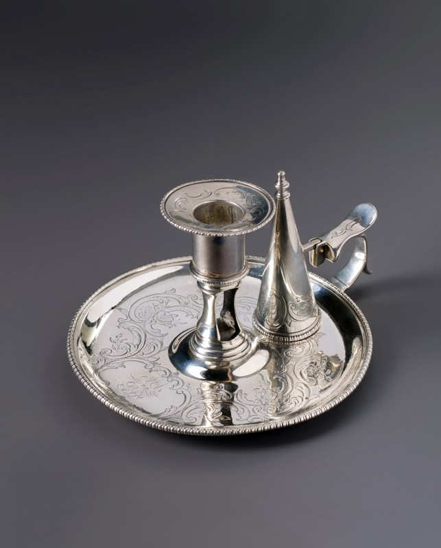 A silver candle holder