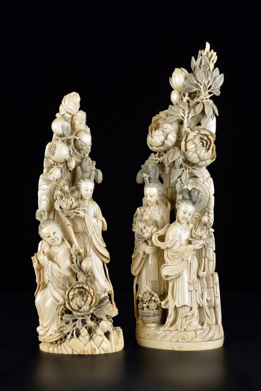 A carved pair of Chinese Qing dynasty figurines, Chinese, 19th Century