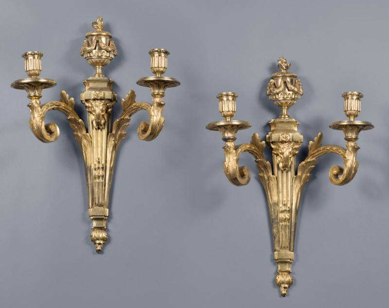 Jean-Charles Delafosse (in the style of), A pair of Louis XVI two-light wall-lights in the style of Jean-Charles Delafosse, Paris, date circa 1770