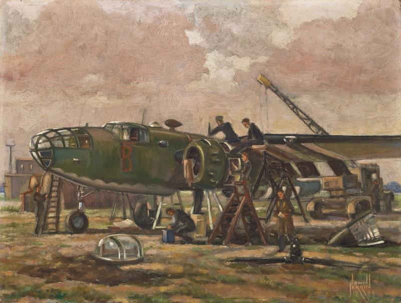 Mechanics working on a North American B-25 Mitchell aircraft at an airfield