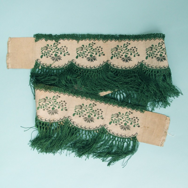 Length of bright green early 19th century woven trimming with silver thread and a scalloped edge.