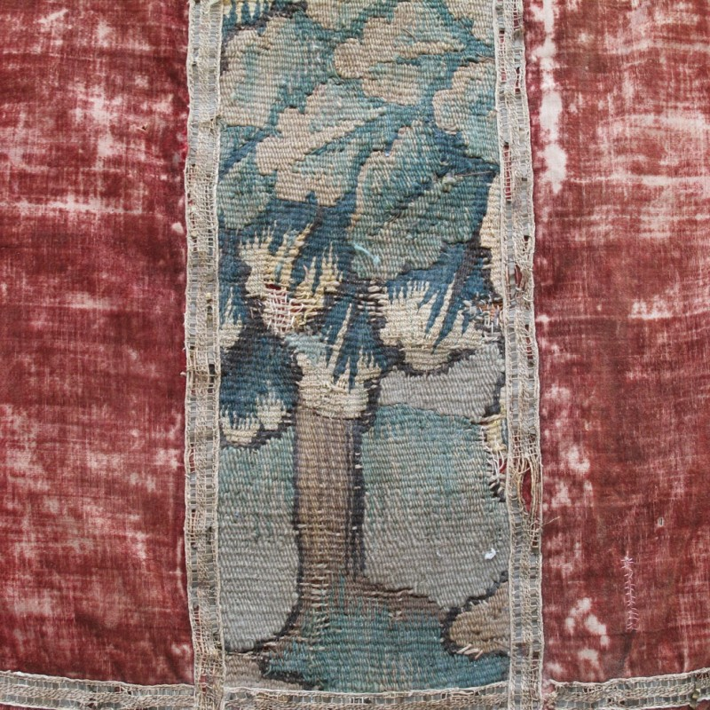 Lovely piece of early 18th century tapestry mounted in faded velvet.
